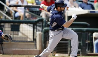 San Diego Padres' Xavier Nady hits a double during the first inning of a spring exhibition baseball game against the Texas Rangers, Sunday, March 23, 2014, in Surprise, Ariz. Two runs scored on the hit. (AP Photo/Darron Cummings)