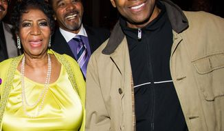 Aretha Franklin and Denzel Washington with Clifton Oliver, rear, attend her 72nd birthday celebration on Saturday, March 22, 2014 in New York. (Photo by Charles Sykes/Invision/AP)