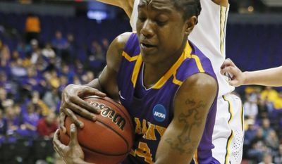 Albany guard Tammy Phillip (14) hauls down a rebound in front of West Virginia forward Jess Harlee in the first half of an NCAA college basketball first-round tournament game on Sunday, March 23, 2014, in Baton Rouge, La. (AP Photo/Rogelio V. Solis)