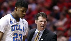 UCLA head coach Steve Alford, right, yells instructions as he removes player Tony Parker from action in the first half of a third-round game in the NCAA college basketball tournament, Sunday, March 23, 2014, in San Diego. (AP Photo/Gregory Bull)
