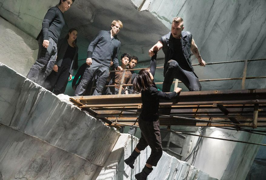 """This photo released by Summit Entertainment shows, from left, Miles Teller, Shailene Woodley, Ben Lamb, Zoe Kravitz, and Jai Courtney, in a scene from the film, """"Divergent."""" The film releases on Friday, March 21, 2014. (AP Photo/Summit Entertainment, Jaap Buitendijk)"""
