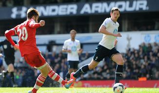 Southampton's Adam Lallana, left, scores his team's second goal of the game during the English Premier League soccer match against Tottenham Hotspurs at White Hart Lane, London Sunday March 23, 2014. (AP {Photo/Adam Davy/PA) UNITED KINGDOM OUT