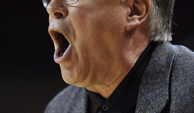 Army head coach  Dave Magarity instructs his team during the first half of the first-round game against Maryland in the NCAA women's college basketball tournament on Sunday, March 23, 2014, in College Park, Md. (AP Photo/Gail Burton)