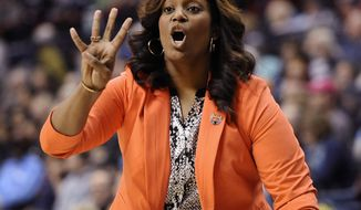 Prairie View A&M head coach Dawn Brown gestures to her team during the first half of a first-round game against Connecticut in the NCAA women's college basketball tournament, Sunday, March 23, 2014, in Storrs, Conn. (AP Photo/Jessica Hill)