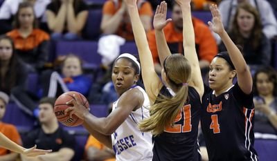 Middle Tennessee State's Ebony Rowe, left, tries to pass around the defense of Oregon State's Sydney Wiese (21) and Breanna Brown (4) in the first half of a first-round game in the NCAA women's college basketball tournament, Sunday, March 23, 2014, in Seattle. (AP Photo/Ted S. Warren)