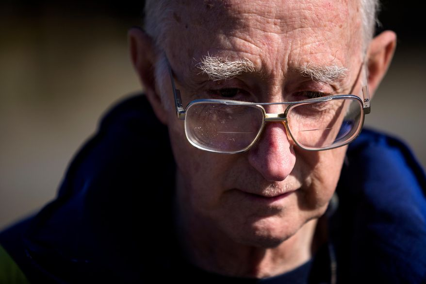 After spending the night at a Red Cross shelter, Reed Miller, 75, recounts the loss of his home in Oso, Wash., Sunday, March 23, 2014, at Post Middle School in Arlington, Wash. Miller was grocery shopping when he was alerted to the mudslide via a phone call. He said he still has not heard from his son. Over a dozen people are unaccounted for after a massive mudslide killed at least three people and destroyed homes, according to authorities Sunday. (AP Photo/seattlepi.com, Jordan Stead)  MAGS OUT; NO SALES; SEATTLE TIMES OUT; TV OUT; MANDATORY CREDIT