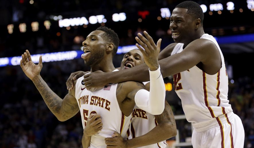 Iowa State's DeAndre Kane (50) is grabbed by teammates Monte Morris, center, and Daniel Edozie, right, after making the game-winning basket against North Carolina during the second half of a third-round game in the NCAA college basketball tournament Sunday, March 23, 2014, in San Antonio. Iowa State won 85-83. (AP Photo/David J. Phillip)