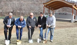 From left, Randy Watson,  Randy Elliott, Butch Tennant, Ernie VanGilder and Chris Spano break ground at Palatine Park on Tuesday, March 18, 2013, in Fairmont, W.Va. The project is nearing completion and will include a splash park, boat ramps and skate park. The Marion County Commission hopes the park will draw in further development that will bring jobs to the community. (AP Photo/Times West Virginian, Chelsi Baker)