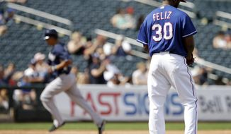 Texas Rangers' Neftali Feliz gets a new baseball after giving up a home run to San Diego Padres' Will Venable during the third inning of a spring exhibition baseball game Sunday, March 23, 2014, in Surprise, Ariz. (AP Photo/Darron Cummings)