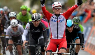 Norway's Alexander Kristoff celebrates as he crosses the finish line to win the Milan-San Remo cycling race, in Sanremo, Italy, Sunday, March 23, 2014. Alexander Kristoff sprinted to victory in the Milan-San Remo classic on Sunday, edging out 2008 winner Fabian Cancellara on a wet and rainy course for the biggest win of his career. Kristoff pulled away in the closing meters to win the 294-kilometer (183 mile) race in 6 hours, 55 minutes, 56 seconds and become the first Norwegian to triumph in the one-day race. (AP Photo/Gian Mattia D'Alberto, Lapresse)