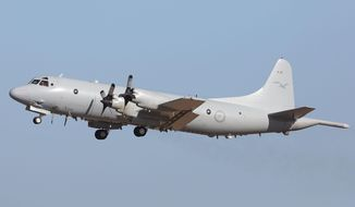 A Royal Australia Air Force AP-3C Orion leaves the RAAF Pearce Air Base,  Sunday, March 23, 2014 in Perth, Australia, to continue the search for missing Malaysia Airlines Flight MH370. Planes and ships scrambled Sunday to find a pallet and other debris in a remote patch of the southern Indian Ocean to determine whether the objects were from the Malaysia Airlines jet that has been missing for more than two weeks.   (AP Photo/Matt Jelonek, Pool)