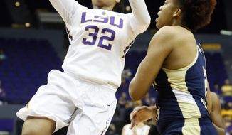 LSU guard Danielle Ballard (32) attempts a layup past the defense of Georgia Tech guard/forward Aaliyah Whiteside (2) in the first half of an NCAA college basketball first-round tournament game on Sunday, March 23, 2014, in Baton Rouge, La. (AP Photo/Rogelio V. Solis)