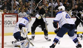 St. Louis Blues goalie Brian Elliott (1) stops a shot by Pittsburgh Penguins' Evgeni Malkin (71) in the second period of an NHL hockey game in Pittsburgh, Sunday, March 23, 2014. (AP Photo/Gene J. Puskar)