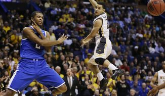 Kentucky guard Aaron Harrison (2) passes the ball as Wichita State guard Fred VanVleet (23) defends during the first half of a third-round game of the NCAA college basketball tournament Sunday, March 23, 2014, in St. Louis. (AP Photo/Jeff Roberson)