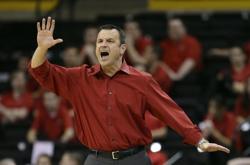 Louisville head coach Jeff Walz shouts to his team during the first half of an NCAA tournament first-round women's college basketball game against Idaho, Sunday, March 23, 2014, in Iowa City, Iowa. (AP Photo/Charlie Neibergall)