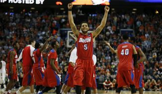 Dayton's Devin Oliver celebrates his team's victory over Syracuse in the third-round game in the men's NCAA college basketball tournament at the First Niagara Center, Saturday, March 22, 2014.  (AP Photo/\Harry Scull Jr./Buffalo News)