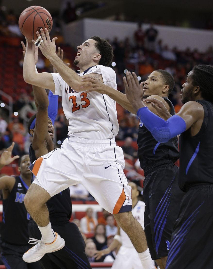 Virginia guard London Perrantes (23) shoots against Memphis during the second half of an NCAA college basketball third-round tournament game, Sunday, March 23, 2014, in Raleigh, N.C. (AP Photo/Chuck Burton)