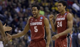 Stanford's Chasson Randle, left, and Josh Huestis celebrate during the second half of a third-round game against Kansas of the NCAA college basketball tournament Sunday, March 23, 2014, in St. Louis. (AP Photo/Jeff Roberson)