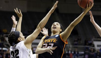 Oklahoma State guard Brittney Martin, right, shoots over Purdue forward Whitney Bays during the first half of a women's second round NCAA tournament college basketball game in West Lafayette, Ind., Monday, March 24, 2014.  (AP Photo/Michael Conroy)