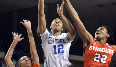 Kentucky's Jelleah Sidney, center, gets a shot up over the defensive pressure of Syracuse's Rachel Coffey, left, and Taylor Ford during the first half of a second-round game in the NCAA college basketball tournament in Lexington, Ky., Monday, March 24, 2014. (AP Photo/Timothy D. Easley)