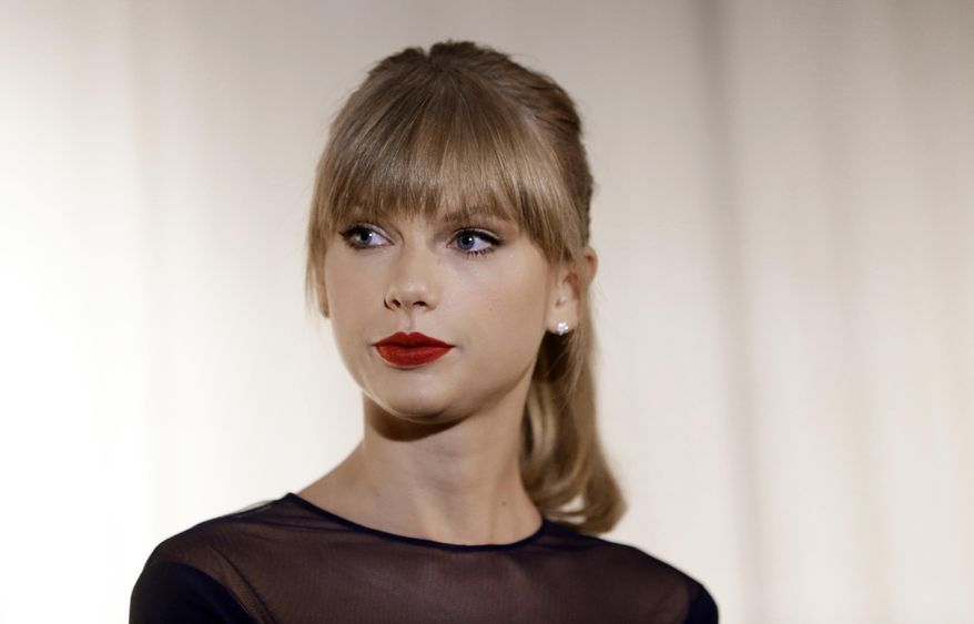 In this Oct. 12, 2103 file photo, Taylor Swift appears at the Country Music Hall of Fame and Museum in Nashville, Tenn.  A 38-year-old Massachusetts man has been ordered to stay away from Taylor Swift's vacation home on the Rhode Island shore. Daniel Cole of Brewster, Mass., was summoned before a state judge Friday, March 21, 214, after police say he ignored previous warnings to not trespass at Swift's mansion in the Watch Hill section of Westerly. Cole pleaded not guilty to trespassing and disorderly conduct charges. A Wakefield District Court judge issued a no contact order and released Cole on personal recognizance. (AP Photo/Mark Humphrey)
