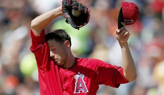 Los Angeles Angels' Tyler Skaggs wipes his face during the second inning of a spring training baseball game against the San Francisco Giants on Monday, March 24, 2014, in Tempe, Ariz. (AP Photo/Ross D. Franklin)