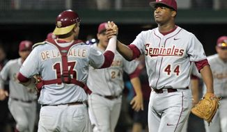 Florida State pitcher Jameis Winston, right, celebrates with catcher Danny de La Calle after the Seminoles swept Clemson in an NCAA college baseball doubleheader at Doug Kingsmore Stadium in Clemson, S.C. on Saturday, March 22, 2014. Florida State won the first game 11-1, and took the nightcap 4-3.(AP Photo/Anderson Independent-Mail, Mark Crammer) GREENVILLE OUT  SENECA OUT