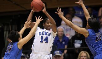 Duke's Ka'lia Johnson (14) looks to pass between DePaul's Jessica January, left, and Centrese McGee, right, during the first half of their second-round game in the NCAA basketball tournament in Durham, N.C., Monday, March 24, 2014.  (AP Photo/Ted Richardson)