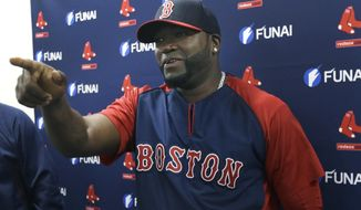 Boston Red Sox designated hitter David Ortiz gestures during a news conference regarding an agreement reached with the team that all but assures the popular slugger will finish his career in Boston, Monday, March 24, 2014 in Sarasota, Fla.  Ortiz and the Red Sox agreed to a 2015 contract Sunday with options for the following two years.  (AP Photo/Carlos Osorio)