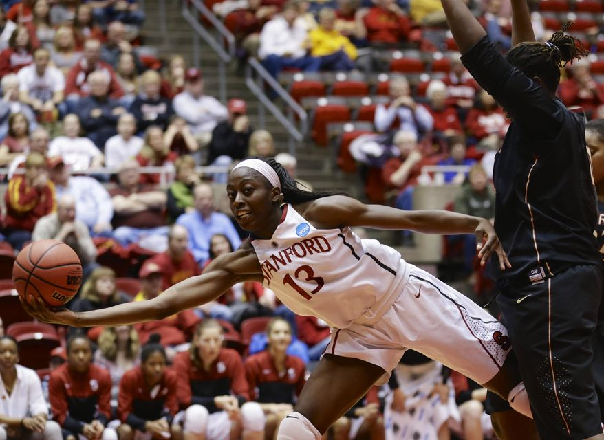 Stanford's Chiney Ogwumike (13) saves a ball from going out of bounds against Florida State's Kai James, right, in the second half of a second-round game in the NCAA women's college basketball tournament in Ames, Iowa, Monday, March 24, 2014. (AP Photo/Nati Harnik)