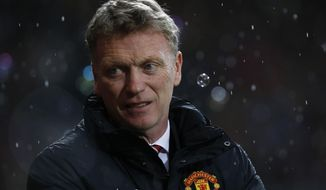 Manchester United's manager David Moyes looks on from the dugout before the start of their English Premier League soccer match against West Ham United at Upton Park, London, Saturday, March 22, 2014. (AP Photo/Sang Tan)