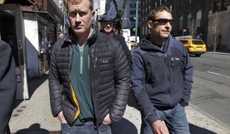 "James Brady, left, and Andrew Rossig, right, two parachutists who jumped from One World Trader Center in September 2013, are accompanied by attorney Timothy Parlatore to surrender to police, in New York,  Monday, March 24, 2014.  Monday's arrests come eight days after a 16-year-old was arrested on charges of climbing up to the top of the nation's biggest skyscraper. Police had no immediate information on Monday's arrests. They had said they were looking for two parachutists seen floating near the building Sept. 30. The defense attorneys say  three accused jumpers and an alleged accomplice on the ground are expecting to face felony burglary charges. The attorneys say the defendants are experienced BASE jumpers, the acronym stands for ""building, span, antenna, earth."" The lawyers say the men took care to keep from endangering anyone. (AP Photo/Richard Drew)"