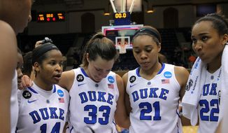 Duke's, from left, Ka'Lia Johnson, Haley Peters, Kendall McCravey-Cooper, and Oderah Chidom huddle after their 74-65 loss to DePaul in their second-round game in the NCAA basketball tournament in Durham, N.C., Monday, March 24, 2014.  (AP Photo/Ted Richardson)