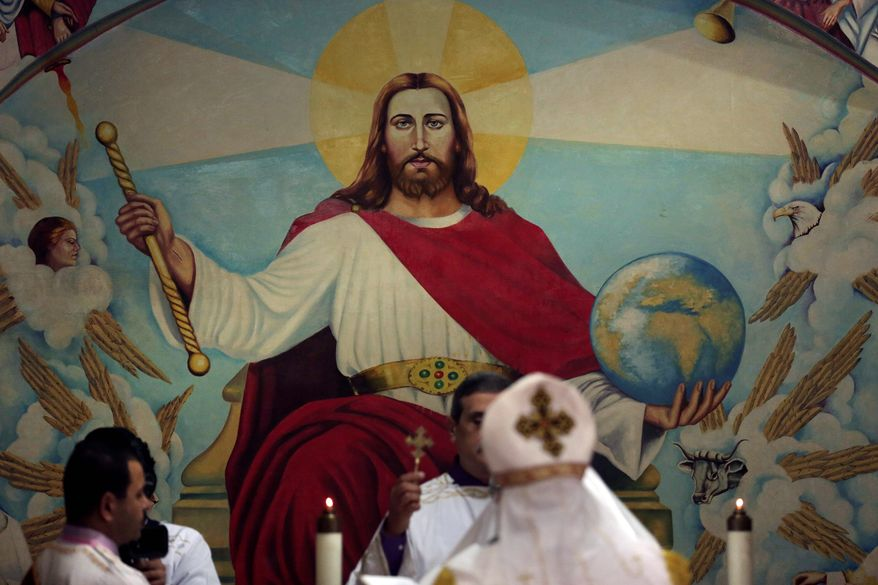An Egyptian priest leads a prayer during midnight Mass on the eve of Orthodox Christmas at the Cave Cathedral or St. Sama'ans Church in the Moqattam neighborhood of Cairo. (Associated Press)
