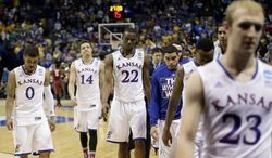 Kansas players walk off the court following their loss in a third-round game against Stanford at the NCAA college basketball tournament Sunday, March 23, 2014, in St. Louis. Stanford won the game 60-57. (AP Photo/Charlie Riedel)