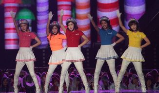 FILE - In this Oct. 6, 2013 file photo, South Korean K-Pop girl group Crayon Pop performs during Hallyu Dream Concert in Gyeongju, South Korea. The pop newcomers Crayon Pop are set to make waves again after Lady Gaga announced the quintet will open for her on her upcoming North American tour. The performers, dressed in white skirts and helmets trimmed with red, blue or yellow, believe their uniqueness will go well with Lady Gaga's style. (AP Photo/Ahn Young-joon, File)