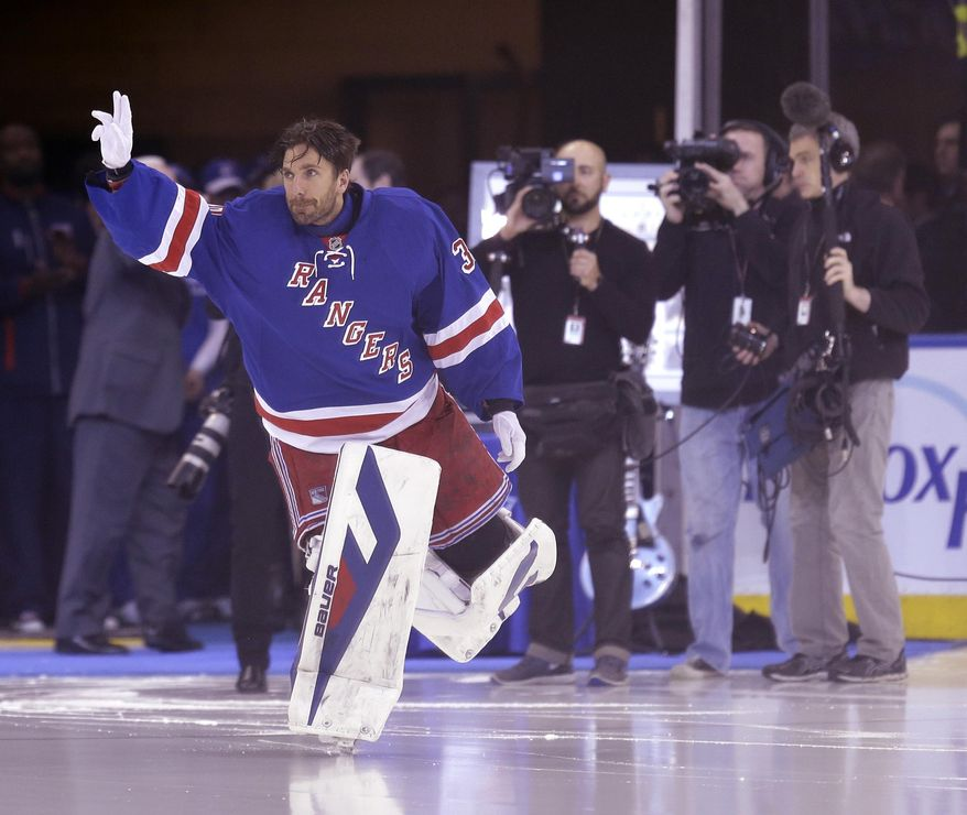 New York Rangers goalie Henrik Lundqvist waves to crowd after being honored for holding the Rangers' records for most wins and most shutouts before the NHL hockey game against the Phoenix Coyotes, Monday, March 24, 2014, in New York. (AP Photo/Seth Wenig)