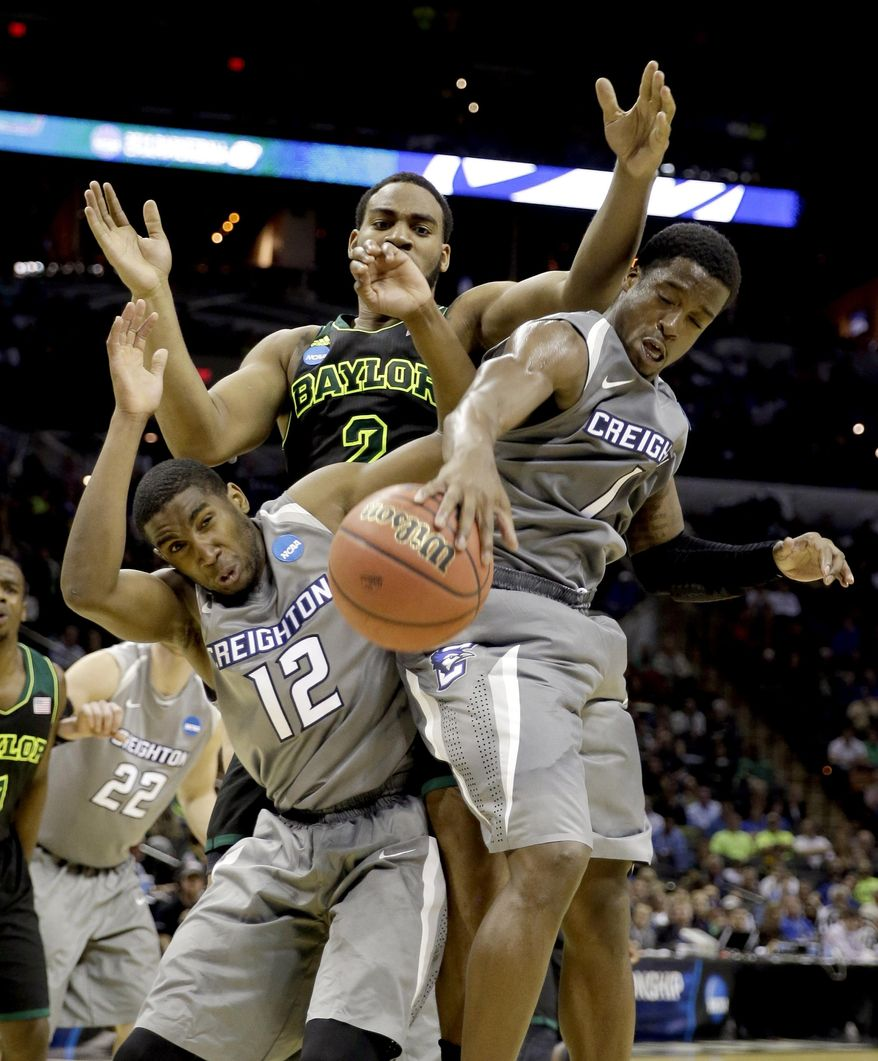 Creighton's Jahenns Manigat (12) and Austin Chatman (1) reach for a rebound in front of Baylor's Rico Gathers (2) during the second half of a third-round game in the NCAA college basketball tournament Sunday, March 23, 2014, in San Antonio. Baylor won 85-55. (AP Photo/David J. Phillip)