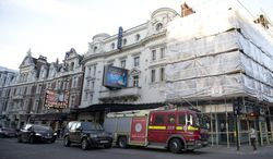 """FILE - In this Friday, Dec. 20, 2013 file photo, a fire brigade truck waits outside The Apollo Theatre in London. Investigators say weakened, century-old cloth and plaster ties caused a partial ceiling collapse that injured almost 80 audience members at London's Apollo Theatre. Local authority Westminster Council said Monday March 24,2014, that the """"principal cause"""" of the collapse was the deterioration of the hessian and plaster of Paris ties, used to bind the timber frames supporting the suspended ceiling. They had been in place since the Apollo Theatre opened in 1901. (AP Photo/Alastair Grant, File)"""