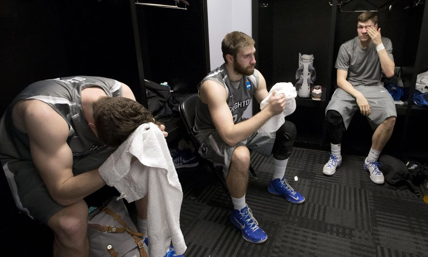 Creighton's Alex Olsen, left, Ethan Wragge, center, and Grant Gibbs, right, sit in their locker room after losing to Baylor in a third-round game in the NCAA college basketball tournament Sunday, March 23, 2014, in San Antonio. Baylor won 85-55. (AP Photo/David J. Phillip)