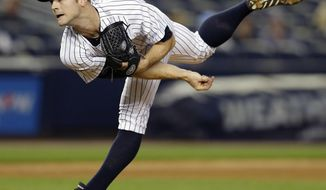 In this Aug. 22, 2013 file photo, New York Yankees reliever David Robertson follows through on a ninth-inning pitch in a 5-3 victory over the Toronto Blue Jays in a baseball game at Yankee Stadium,  in New York. With Mariano Rivera relaxing in retirement, Robertson takes over for the greatest closer in baseball history.(AP Photo/Kathy Willens, File)