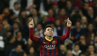Barcelona's Lionel Messi from Argentina, left, celebrates his goal  during a Spanish La Liga soccer match between Real Madrid and FC Barcelona at the Santiago Bernabeu  stadium in Madrid, Spain, Sunday, March 23, 2014. (AP Photo/Andres Kudacki)