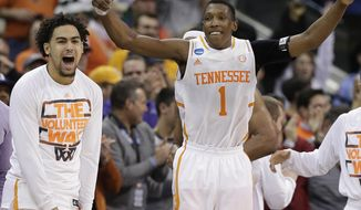 Tennessee guard Josh Richardson (1) celebrates after the second half of an NCAA college basketball third-round tournament game against Mercer, Sunday, March 23, 2014, in Raleigh. Tennessee Won 83-63. (AP Photo/Chuck Burton)