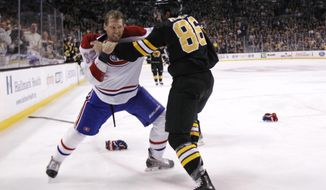 Boston Bruins defenseman Kevan Miller (86) fights with Montreal Canadiens left wing Travis Moen (32) during the first period of an NHL hockey game, Monday, March 24, 2014, in Boston. (AP Photo/Charles Krupa)