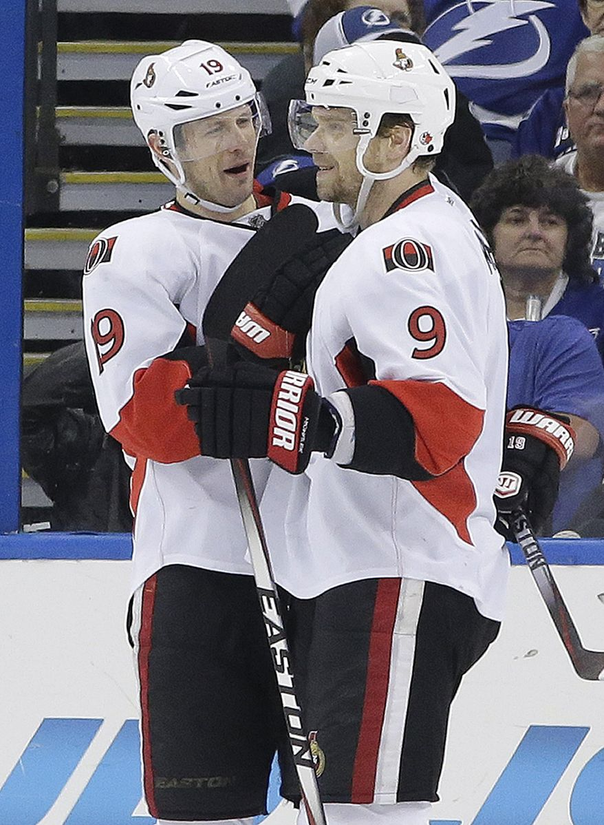 Ottawa Senators center Jason Spezza (19) celebrates his goal against the Tampa Bay Lightning with teammate left wing Milan Michalek (9), of the Czech Republic, during the second period of an NHL hockey game Monday, March 24, 2014, in Tampa, Fla. (AP Photo/Chris O'Meara)
