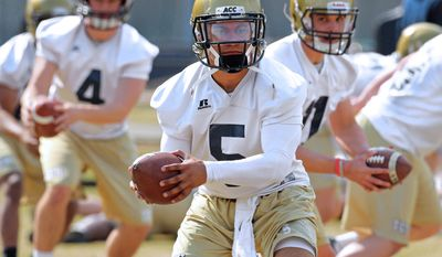 Georgia Tech quarterbacks, from left,   Brady Swilling,  Justin Thomas, and freshman Matthew Jordan run through drills on the first day of spring football practice on Monday, March 24, 2014, in Atlanta.   (AP Photo/Atlanta Journal-Constitution, Curtis Compton)  MARIETTA DAILY OUT; GWINNETT DAILY POST OUT; LOCAL TV OUT; WXIA-TV OUT; WGCL-TV OUT