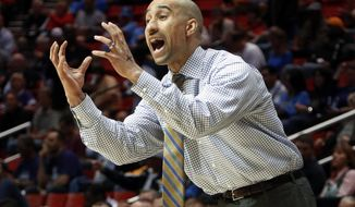 Virginia Commonwealth head coach Shaka Smart gestures as his team plays Stephen F. Austin in the first half of a second-round game in the NCAA college basketball tournament Friday, March 21, 2014, in San Diego. (AP Photo/Lenny Ignelzi)