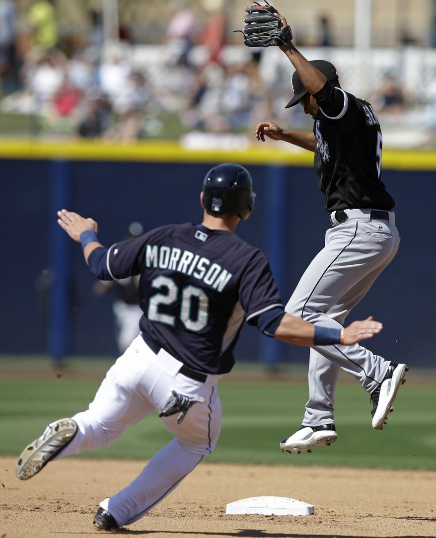 Seattle Mariners' Logan Morrison is forced out at second as Chicago White Sox's Marcus Semien leaps to take the throw during the fourth inning of a spring exhibition baseball game Monday, March 24, 2014, in Peoria, Ariz. (AP Photo/Darron Cummings)