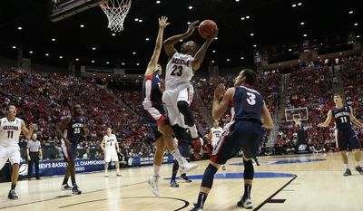 Arizona forward Rondae Hollis-Jefferson (23) shoots over Gonzaga forward Drew Barham during the first half of a third-round game in the NCAA college basketball tournament Sunday, March 23, 2014, in San Diego. (AP Photo/Lenny Ignelzi)