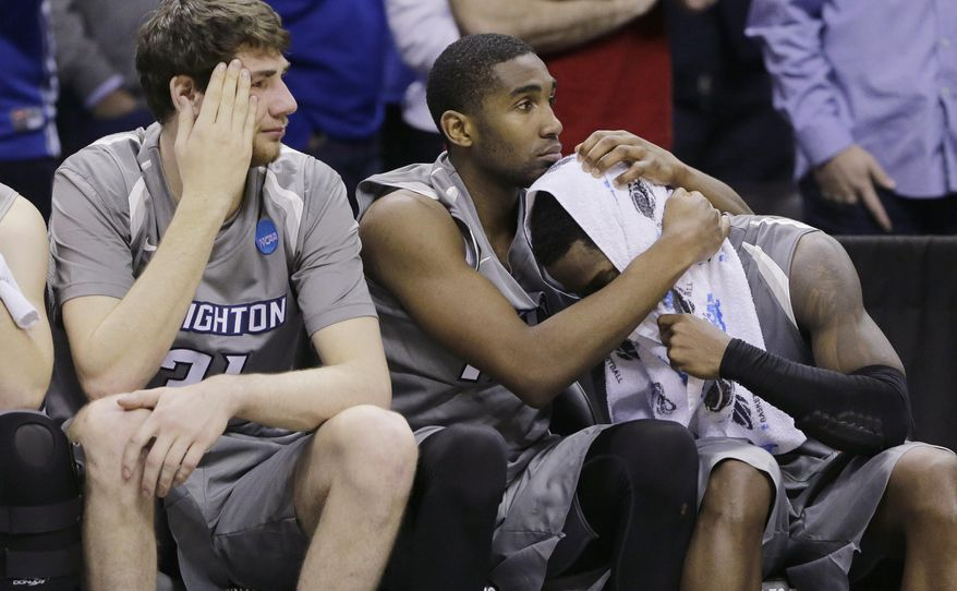 Creighton's Austin Chatman, right, is comforted by teammate Jahenns Manigat, center, during the final moments in the second half of a third-round game against Baylor in the NCAA college basketball tournament Sunday, March 23, 2014, in San Antonio. Baylor won 85-55. Creighton's Will Artino is at left. (AP Photo/Eric Gay)